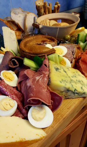 Food Food And Drink Ready-to-eat SLICE No People Freshness Healthy Eating Plate Meal Meat Olive Cheese Cheese Platter Meat Platter Pork Pie Feast Cold Cuts Home Boiled Eggs Meat And Cheese Plate Celebration Cold Food