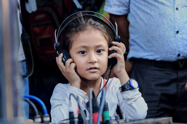Portrait of cute girl wearing headphones