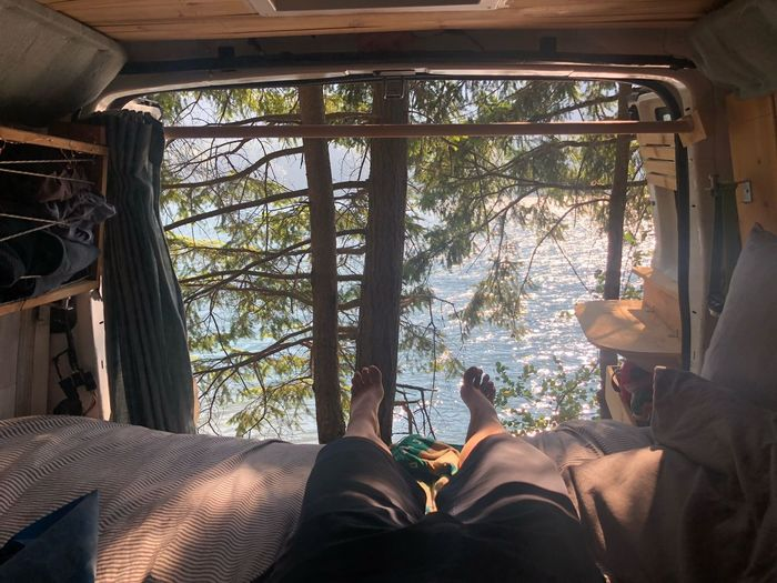 Low section of man relaxing in motor home