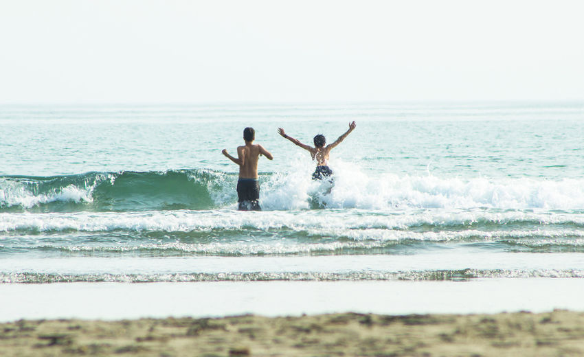 Brothers Sea Water Land Leisure Activity Beauty In Nature Brothers Adventure Ocean Playing Lifestyles Splashing Freedom California Travel Destinations Nature Outdoors Motion Human Connection Moments Of Happiness 2018 In One Photograph