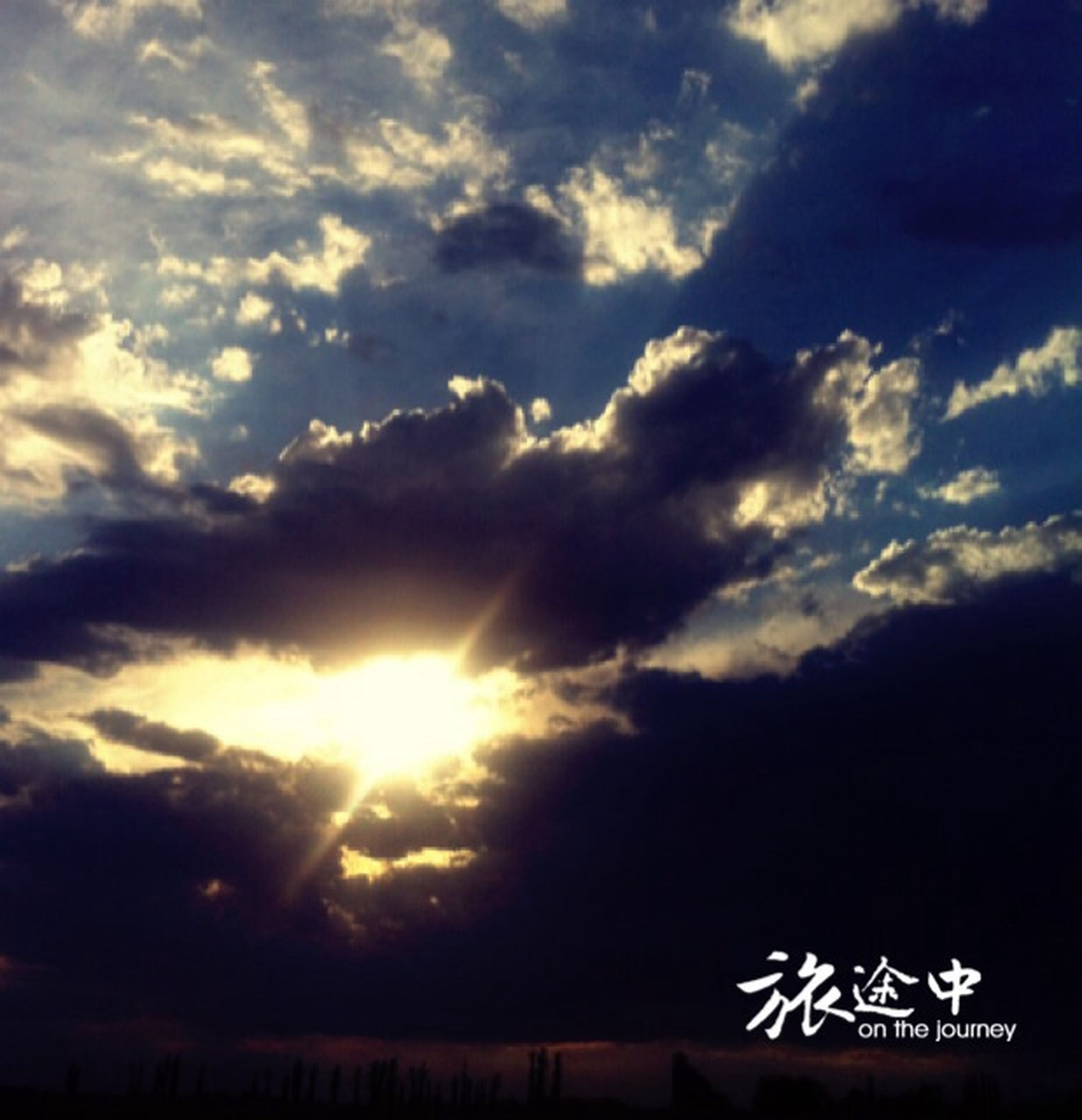 sky, cloud - sky, sun, tranquility, sunbeam, beauty in nature, scenics, tranquil scene, nature, silhouette, sunlight, cloudy, cloud, low angle view, cloudscape, sunset, idyllic, outdoors, no people, weather