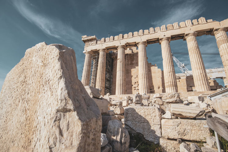 Acropolis Athens Greece Acropolis Architecture History Built Structure Sky Ancient Old Ruin The Past Architectural Column Travel Travel Destinations Ancient Civilization Nature Tourism Building Exterior Sunlight Cloud - Sky Low Angle View Day City Rock Archaeology No People Ruined Outdoors