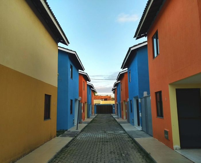 Alley Architecture Building Building Exterior Built Structure City Day Diminishing Perspective Direction Empty Footpath In A Row Narrow Nature No People Outdoors Residential District Sky Street The Way Forward