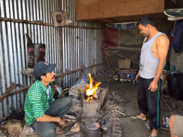 Fire - Natural Phenomenon Flame Burning Men Heat - Temperature Lifestyles Holding Preparation  In Front Of Full Length Casual Clothing Togetherness Outdoors Forge  Pan Day Innocence