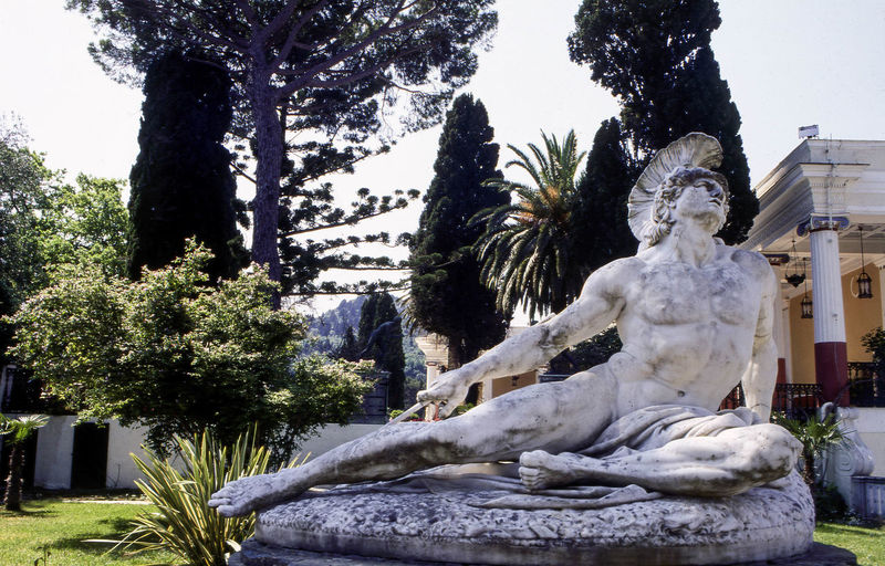 Statue of Dying Achilles (Achilleas thniskon) in the gardens of the Achilleion Palace, Corfu, Greece Achilleion Palace Achilles Statue Art And Craft Classical Corfu, Greece Gastouri Human Representation Kerkyra_corfu Greece Male Likeness Marble Mortally Wounded Mythology Neoclassical No People Outdoors Park - Man Made Space Romanticism Sculpture Statue Statue Travel Photography Wounded