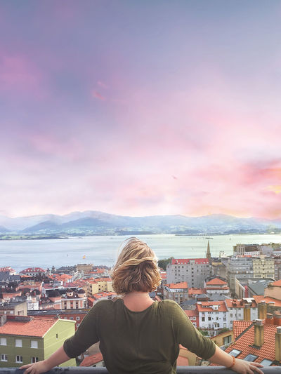 Pink Sky SPAIN Santander Architecture Blond Hair Building Exterior Built Structure City City Life Cityscape Crowded Day Girl High Angle View House One Person Outdoors People Rear View Residential District Roof Sea Sky Sunset Town