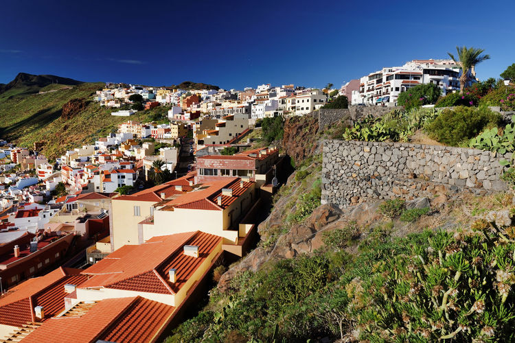 High angle view of buildings against clear sky at san sebastian de la gomera