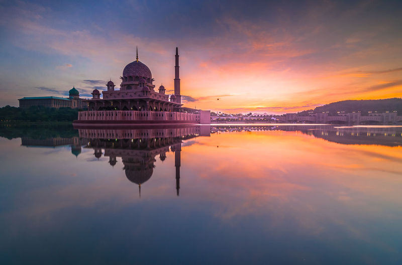 View Of Putra Mosque By Lake At Sunrise