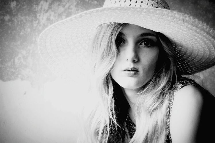 EyeEmNewHere EyeEm Best Shots - Black + White EyeEm Selects Portrait Photography Girl With Hat Portrait Young Women Beautiful Woman Water Headshot Front View Beauty Close-up Thoughtful Pretty