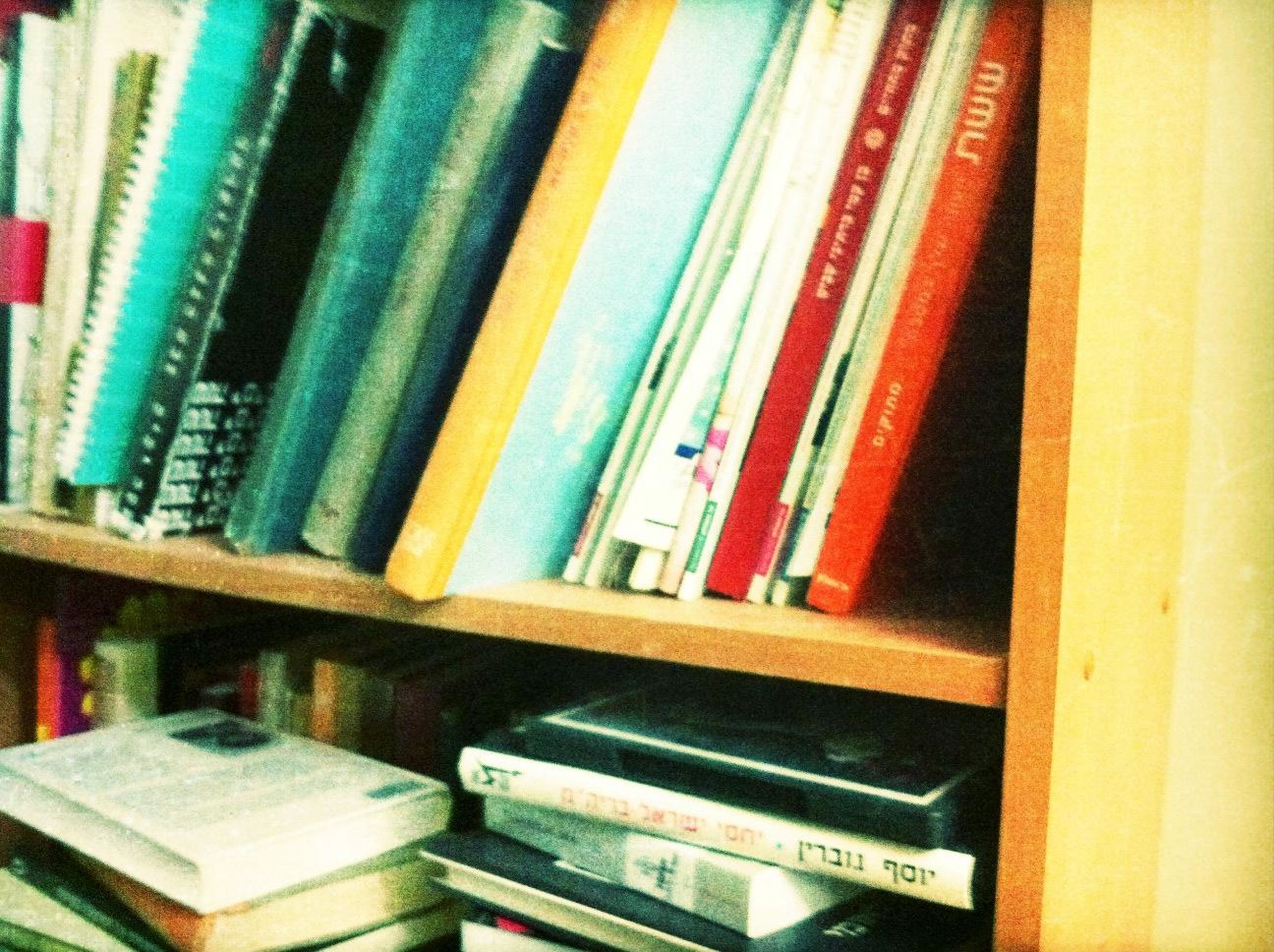 indoors, education, book, multi colored, in a row, close-up, wood - material, variation, no people, still life, stack, large group of objects, order, full frame, literature, shelf, arrangement, absence, choice, high angle view