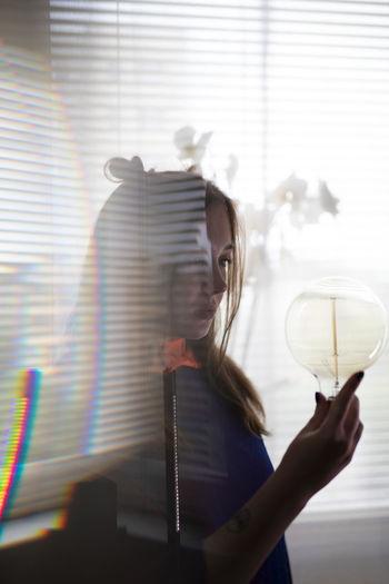 Woman holding glass window