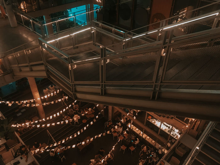 High angle view of people in illuminated mall