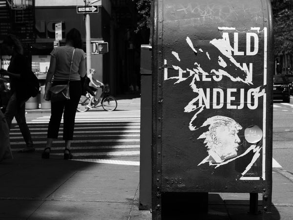 Donald Eres Un Pendejo NYC Street Photography No More Trump Architecture Black And White Photography Built Structure City Communication Day Full Length Men Nyc Streets Outdoors Pedestrian People Real People Road Road Sign Text Women