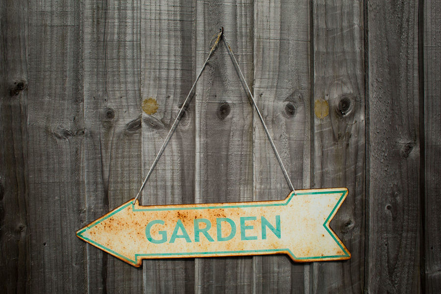 Enamelled metal garden sign showing signs of ageing in our garden. Moordown Gardening Bournemouth