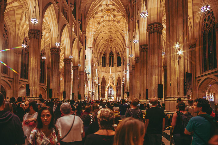 St. Patrick's Cathedral Group Of People Crowd Architecture Religion Large Group Of People Belief Real People Spirituality Built Structure Place Of Worship Building Building Exterior Tourism Arch Architectural Column Ceremony Gold Gold Colored