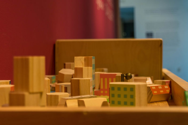 Creativity Kids Activity Architectural Model Box Box - Container Business Cardboard Cardboard Box Close-up Container Indoors  Industry Large Group Of Objects No People Playing Selective Focus Stack Still Life Table Toy Toy Block Variation Wood - Material