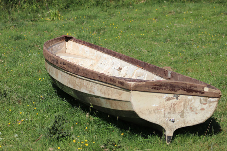 Rowing boat sat on the grass