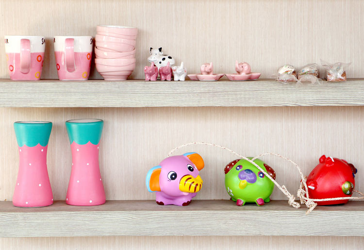 wooden shelves and the dish and vase and household appliances made of ceramic in Thailand. Cup Household Appliances Rice Bowl Doll Toy Vase Plate Shelves Wooden Wooden Shelves Ceramic Ceramic Cup Ceramic Vase Ceramic Plate Thailand Thai Health Healthcare Summer Holiday Recreation  Multi Colored Easter Celebration Easter Egg Prepared Food Toy Animal Tea Coffee Colored Pencil