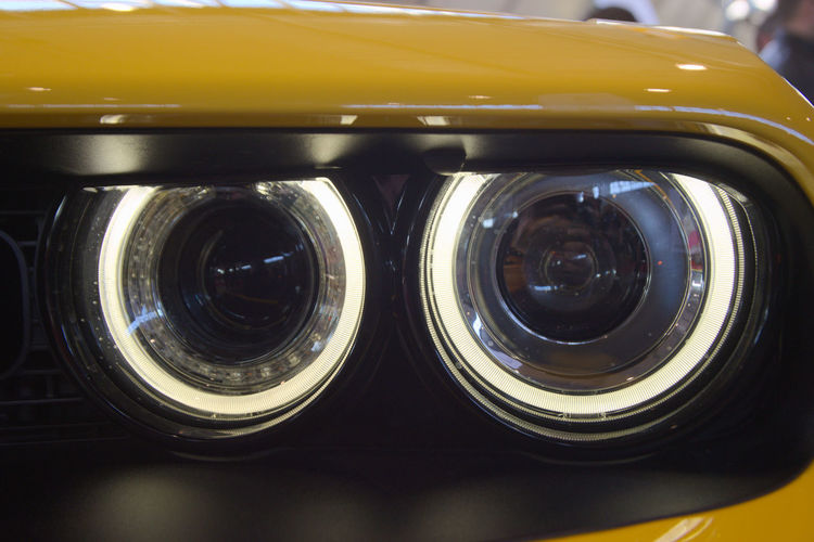 Classic Car Futuristic Lights Mobility in Mega Cities Retro Car Car Detail Car Front Close-up Day Detail Eyes Headlight Headlights Indoors  Mobility Mobility Concepts Nikonphotography No People Oldtimer Rings Round Showroom Technology Yellow