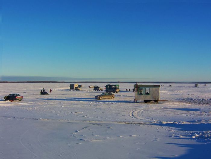 Wonderful day on a frozen lake with nice little huts to do some ice fishing. Ice Fishing Beach Beauty In Nature Blue Clear Sky Day Ice Fishing Huts Ice Fishing Huts On Frozen Lake At Sunset Nature No People Outdoors Sand Scenics Sea Sky Sunlight Transportation