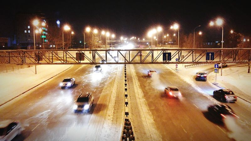 Night Illuminated Transportation Lighting Equipment Car Bridge - Man Made Structure Motion City Outdoors No People Snowing Sky -30°C Cold Temperature Winter Bridge Cars -22°F Cold Weather