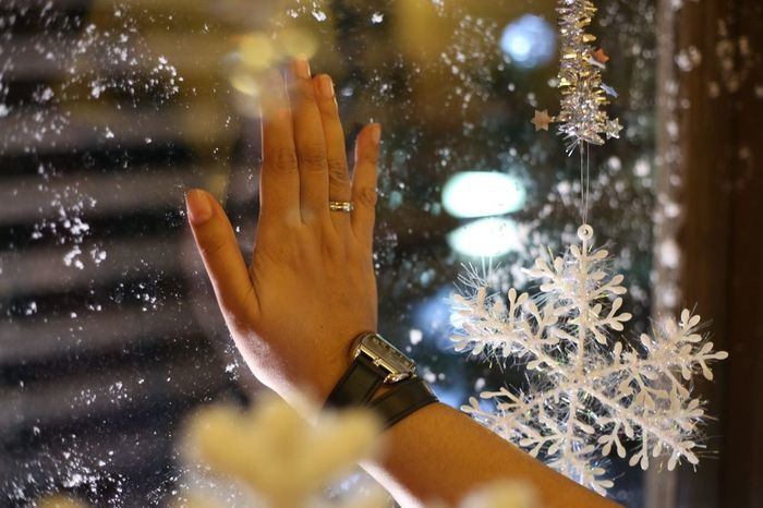 Touching Window Hand Christmas