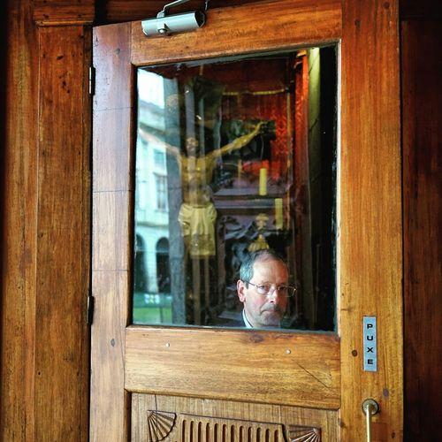 Portrait of man seen through window