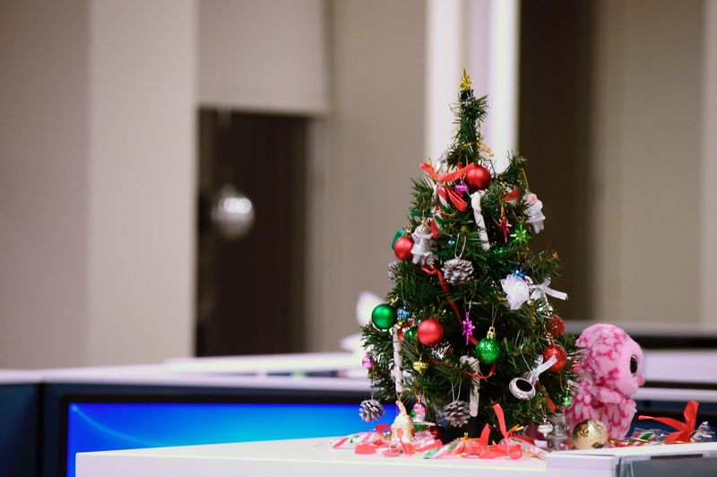 Close-up of christmas tree on table at home