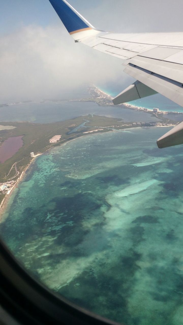 airplane, aerial view, transportation, journey, airplane wing, flying, travel, aircraft wing, air vehicle, mid-air, mode of transport, window, no people, landscape, nature, sky, beauty in nature, sea, day, vehicle part, scenics, water, outdoors, view into land