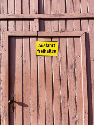 Information sign on wooden door