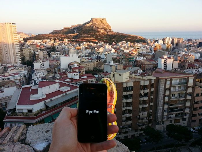 Eyeem :) Human Hand Cityscape Urban Skyline City Outdoors One Person People Human Body Part Day Adult EyeEm Smartphonephotography Smartphone Smartphone Photos Castle Sea Mediterranean  Alicante Eyeem Mission Mobile Conversations Mobile_photographer Mobile Phone Smartphone Addict Mobile Addiction Mobile Addict
