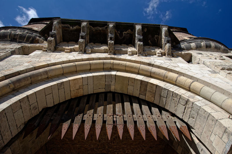 Historical Building Ancient Arch Architecture Built Structure Day History Low Angle View Medieval Architecture Outdoors Portcullis Severinstorburg Sky Sunlight Travel Destinations