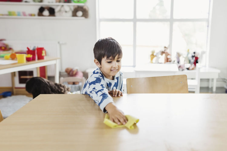 Portrait of boy and table at home