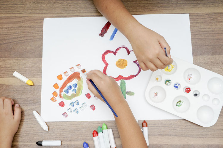 Art And Craft Kindergarten Paint Preschool Art And Craft Art And Craft Equipment Arts Culture And Entertainment Body Part Brushes Child Childhood Creativity Drawing - Art Product Education Finger Hand High Angle View Holding Human Body Part Human Hand Indoors  Leisure Activity Lifestyles One Person Palette Paper Real People Table Watercolor Paints Women