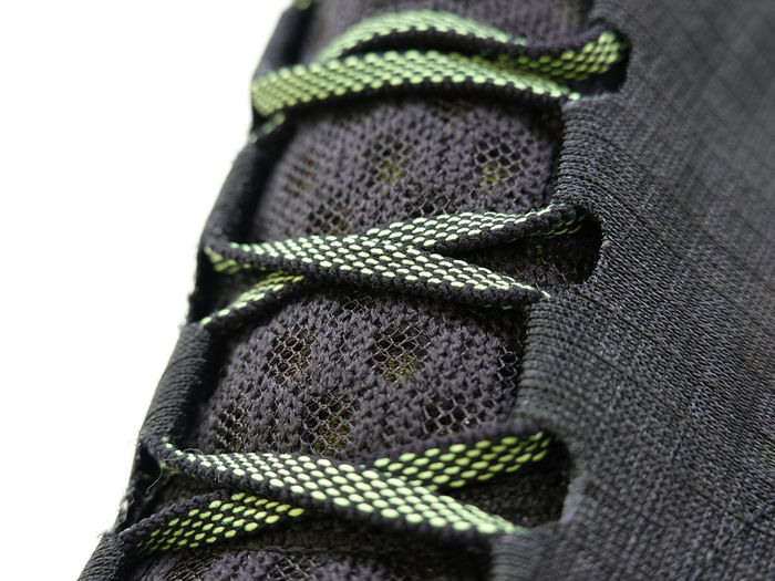 Black Color Close-up Clothing Fashion Gray Green Color High Angle View Indoors  Lace - Fastener No People Pattern Personal Accessory Scarf Security Selective Focus Skechers Still Life Studio Shot Textile Textured  Warm Clothing White Background Winter Wool