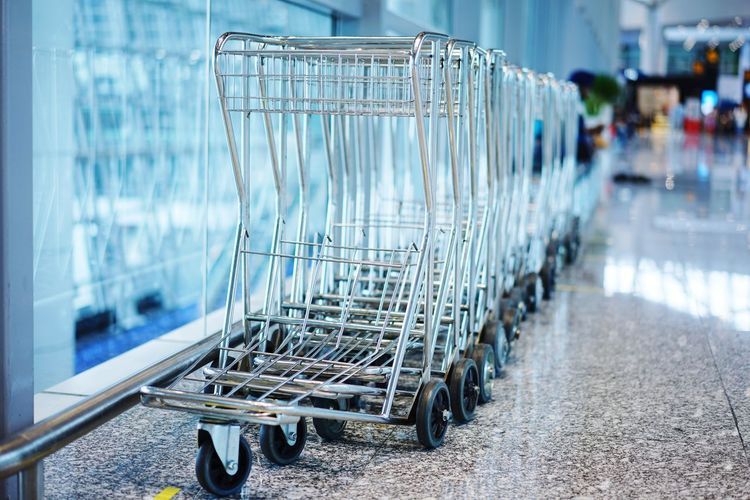 Empty Shopping Carts In Supermarket