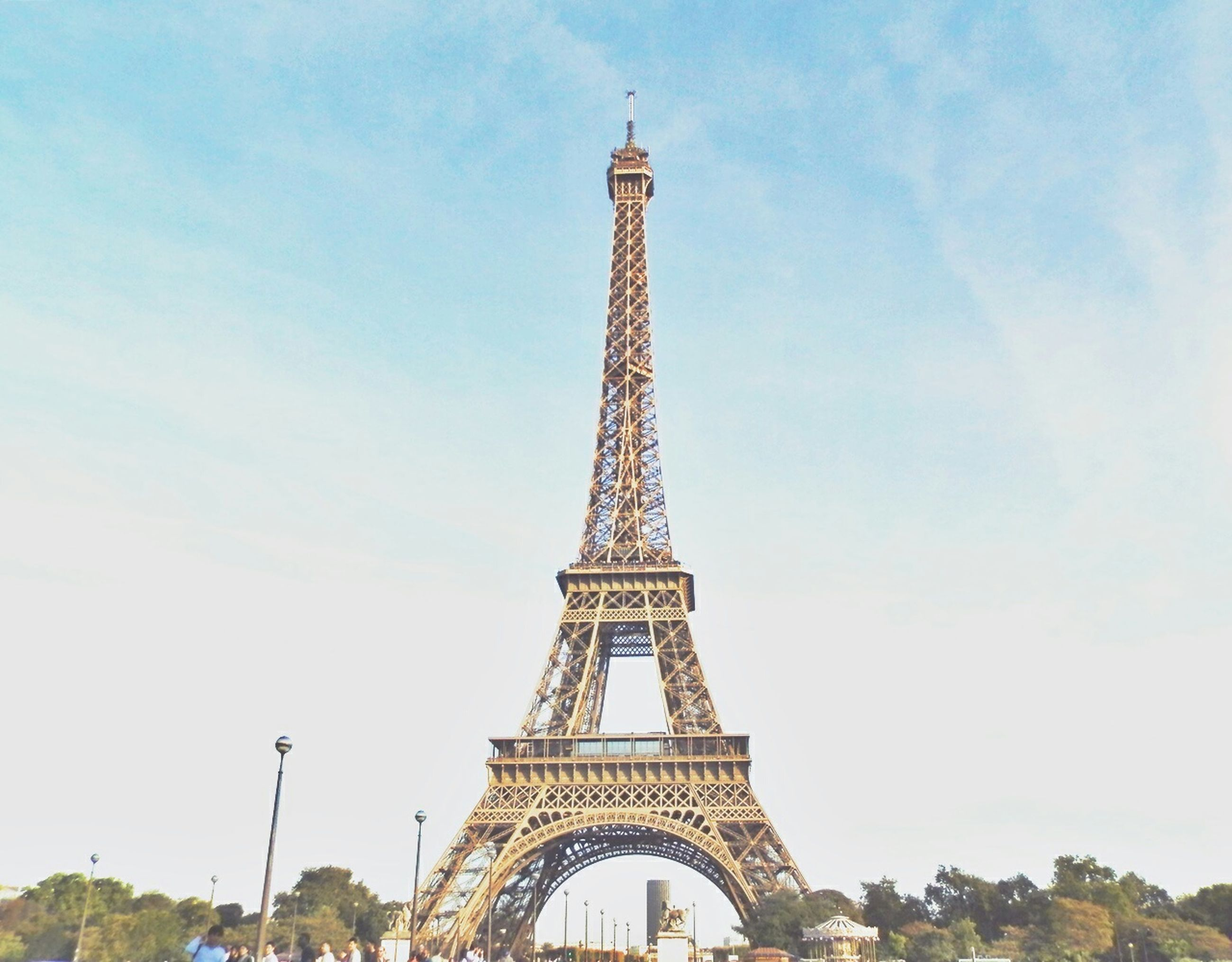 eiffel tower, tower, architecture, famous place, built structure, international landmark, travel destinations, tall - high, tourism, capital cities, sky, culture, travel, low angle view, history, metal, building exterior, architectural feature, tree, city