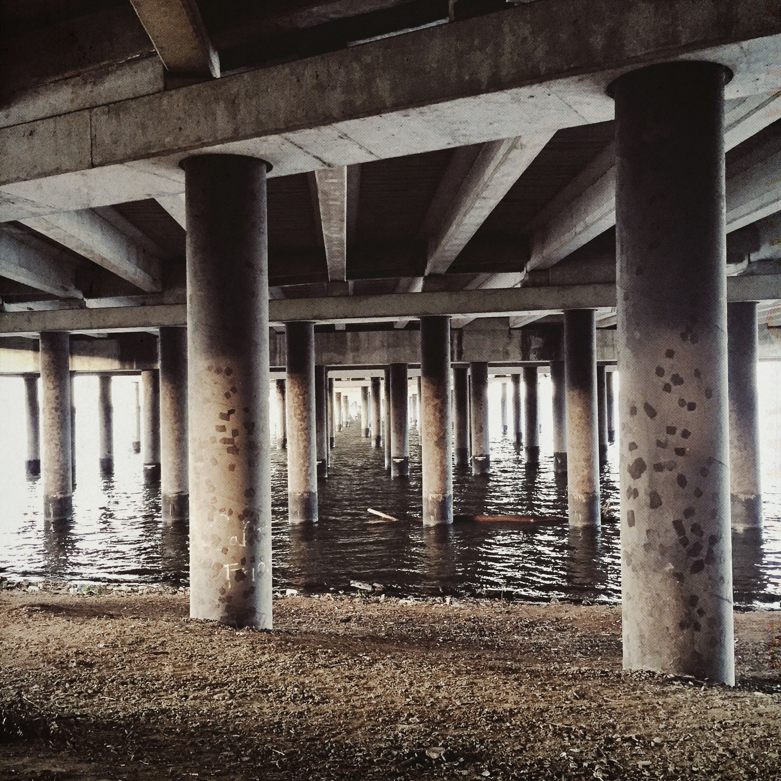 built structure, architectural column, architecture, column, water, in a row, support, bridge - man made structure, pier, sea, pillar, below, colonnade, connection, sunlight, day, wood - material, beach, bridge, no people