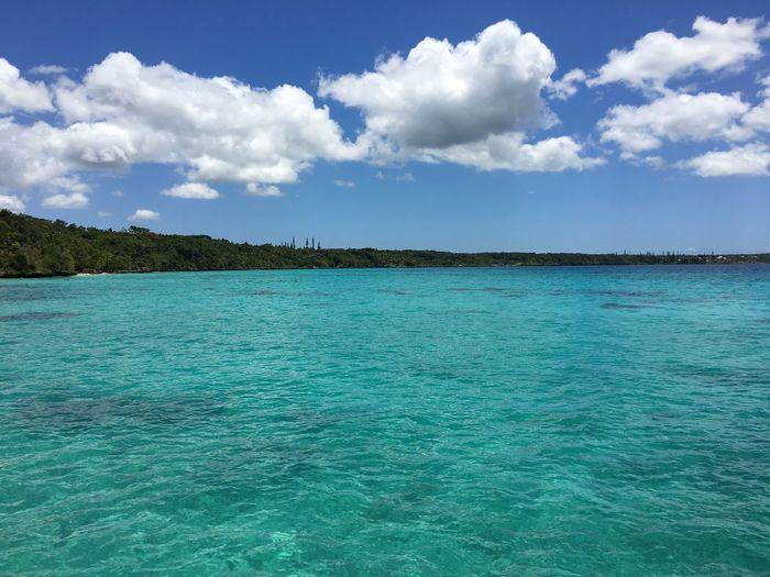 Blue Water Sea Cloud - Sky Sky Beauty In Nature Scenics Cloud - Sky Blue Tranquility Tranquil Scene Nature Sea Idyllic Outdoors Day Water No People Landscape Tree Summer Exploratorium