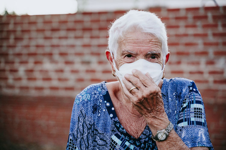 Close-up portrait of senior woman wearing mask