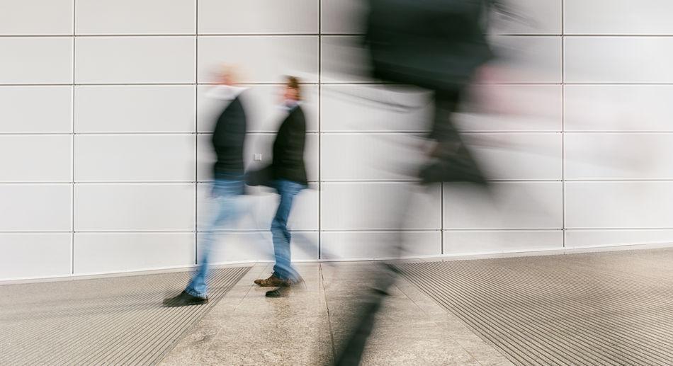 Blurred Motion Of People Walking In Corridor