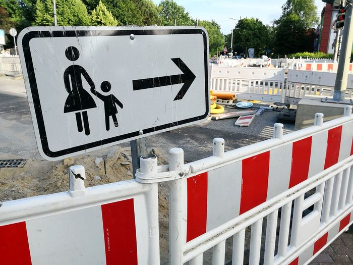 Construction site on road pedestrian deviation Construction Site Construction Work Deviation Symbol Woman And Child Road Sign Information Directional Sign Arrow Symbol Street Name Sign One Way Signboard Warning Information Sign Traffic Arrow Sign Arrow Sign