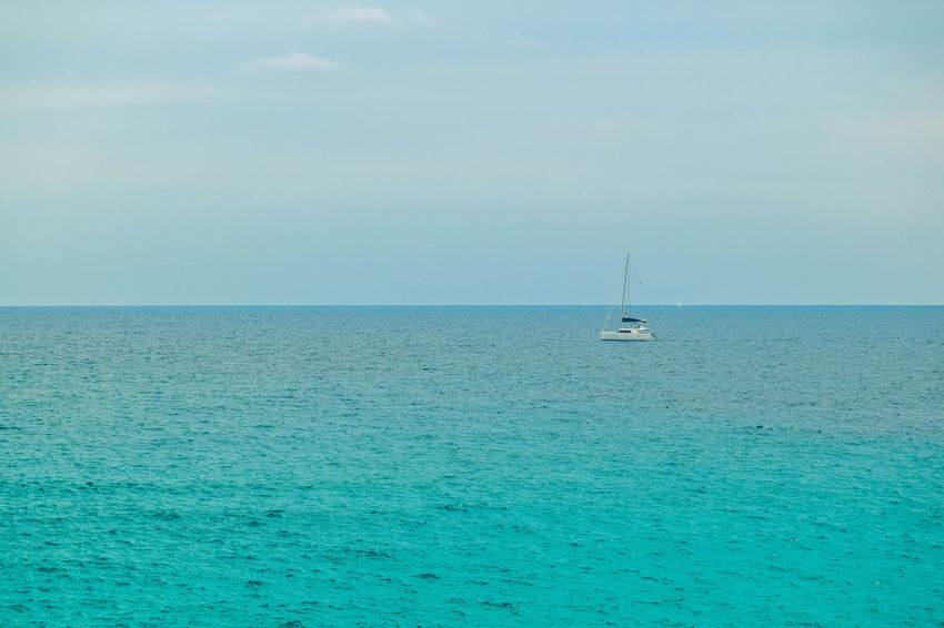 Beauty In Nature Blue Day Horizon Horizon Over Water Idyllic Luxury Mode Of Transportation Nature Nautical Vessel No People Sailboat Sailing Scenics - Nature Sea Sky Tranquil Scene Tranquility Transportation Turquoise Colored Water Waterfront Yacht Yachting