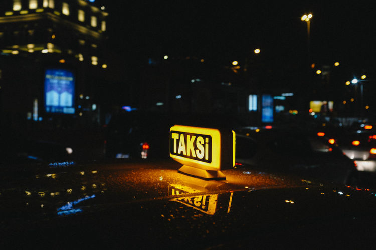 Car City City Life Cityscape Communication Dark Illuminated Night No People Road Sign Street Taxi Text Transportation Western Script