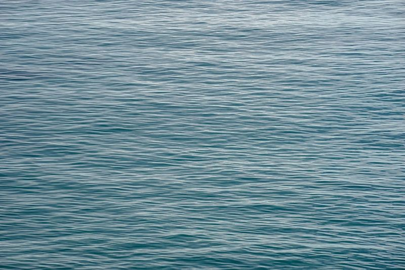 Calm ripples up close Sea Backgrounds Nature Rippled No People Water Full Frame Beauty In Nature Tranquility Blue Textured  Outdoors Scenics Day