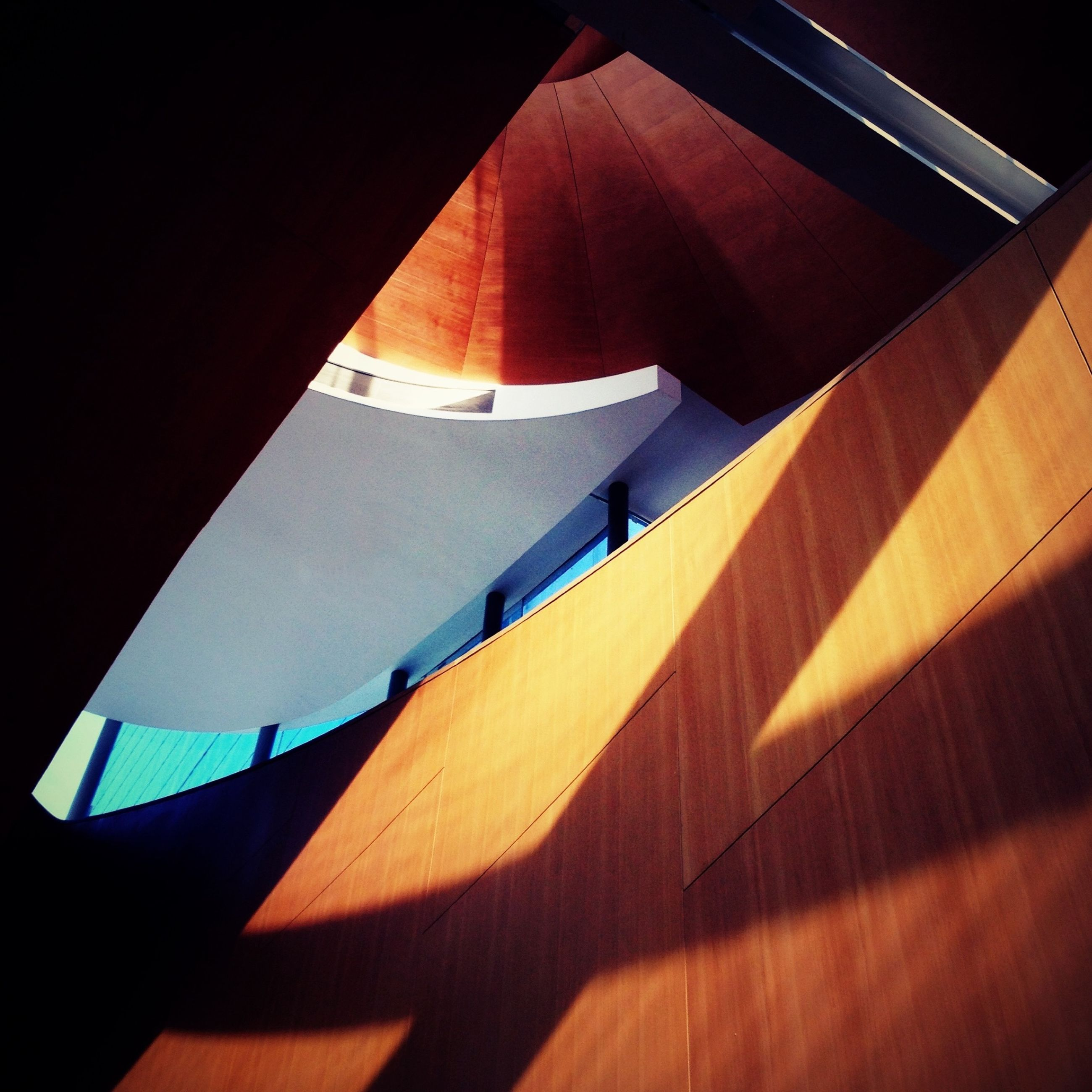 indoors, shadow, high angle view, sunlight, low angle view, table, no people, wood - material, tilt, built structure, absence, architecture, reflection, empty, day, hanging, still life, lighting equipment, modern, auto post production filter