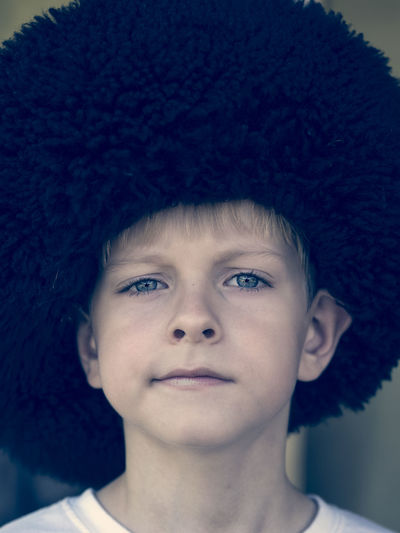 Little Caucasian boy in the Cossack fur hat of the Civil War 1917 - 1921 in the Russian Empire 1917 1921 Black Hair Boy Boys Caucasian Childhood Civil Close-up Cossack Elementary Age Empire Front View Fur Hat Headshot Innocence Leisure Activity Little Looking At Camera Person Portrait Russian Toddler  War