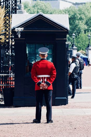 The Queen's Guard British Buckingham Palace London Queen's Guard Security Soldier United Kingdom Adventures In The City Army Army Life Army Soldier Clothing England Government Hat Men Occupation Protection Real People Rear View Red Royal Security Standing Uniform