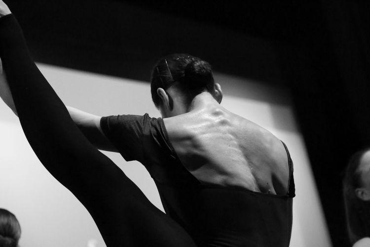 Rear view of ballet dancer practicing in dance studio
