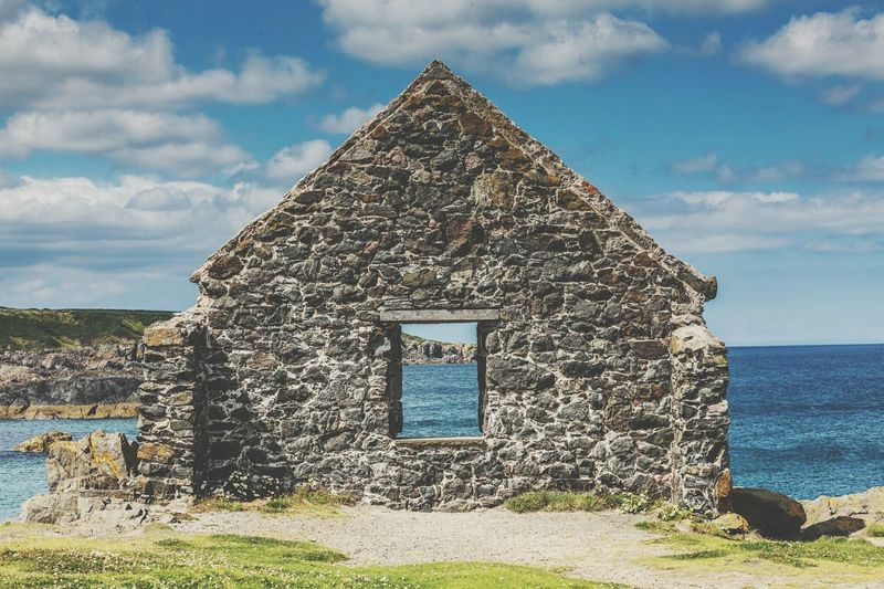 Sky Blue Cloud - Sky Architecture Built Structure Outdoors Beauty In Nature Nature Ruined Ruins Architecture Ruins Cottage Scotland Scottish Scenery View From The Window... View Of The Sea Old Buildings Old Ruin Old House Travel Travel Destinations Perspective Photography